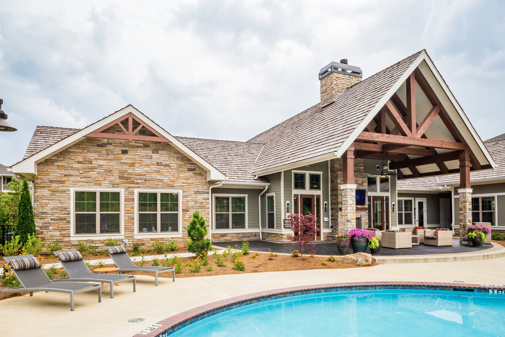 Beautiful pool area at this luxury apartment building which uses Cultured Stone's Country Ledgestone in Aspen to add texture to the country-chic appearance.