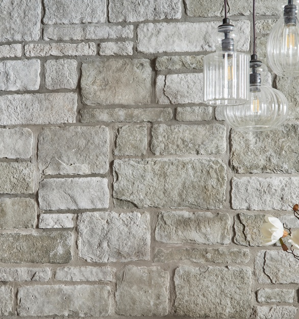 Cultured Stone's sculpted ashlar in silver shore is mixed stone sizes which bring natural warmth to any interior or exterior.