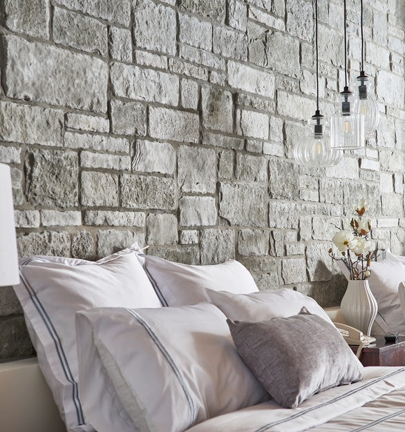The beautiful stone wall treatment by Cultured Stone is described as a modern touch on a classic charm.
