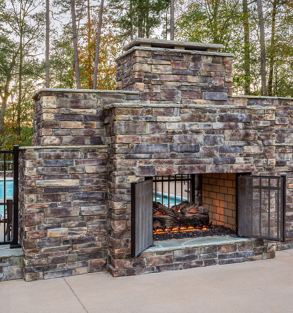Eldorado Stone's Country Ledgestone in Wolf Creek® was used for the fireplace outside by the pool area.