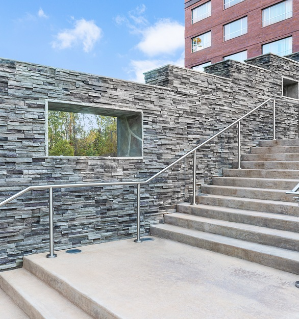 Cultured Stone veneer caters to any size project. Seen here used for the exterior stairway at the Stateview hotel.