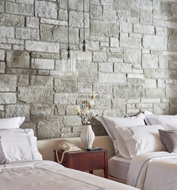 The size and shapes of the Cultured Stone's sculpted ashlar in silver shore bring texture and depth to the beautiful wall treatment in this hotel room.