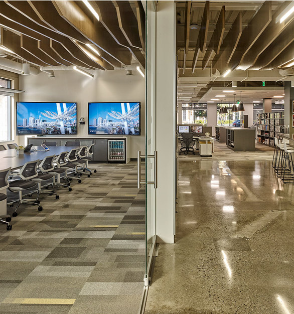 Upon entering the new Las Vegas Cuningham Group office is an eye-catching custom Mojave-layered ceiling feature. It provides a subtle connection to nature and the sedimentary beauty of the desert.
