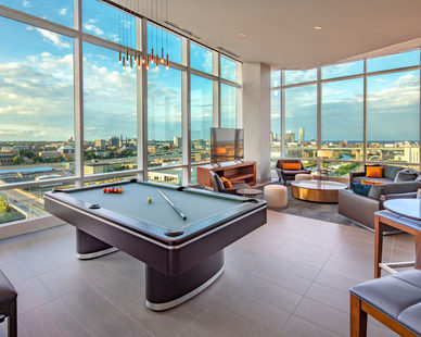 The Potawatomi Hotel in Milwaukee, Wisconsin offers a variety of different suite styles with modern furnishings and design elements, by Cuningham Group.