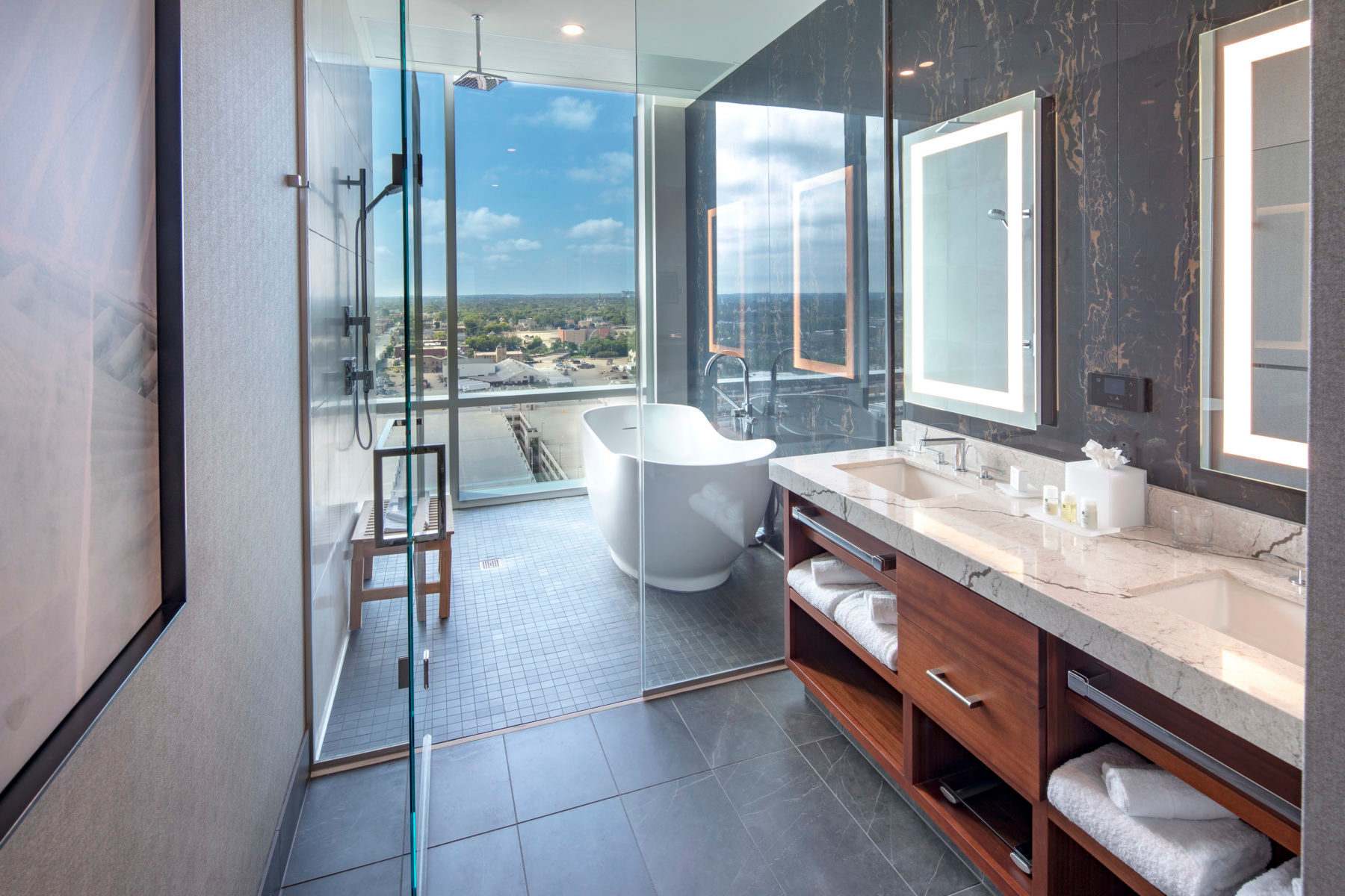 A luxurious spa-inspired bathroom at the Potawatomi Hotel, designed by Cuningham Group.
