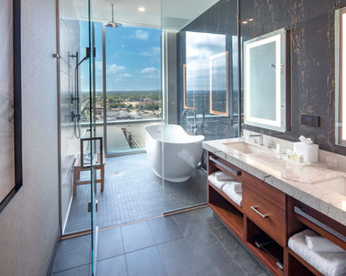 Cuningham group designed a luxurious space-inspired hotel bathroom at Potawatomi Hotel.