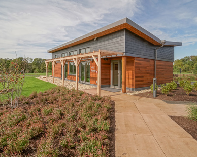 Ample outdoor space encourages healthy learning and teaching at Slate School. The wood and natural slate finishes throughout the property complements the outdoor landscaping and nature-filled area.