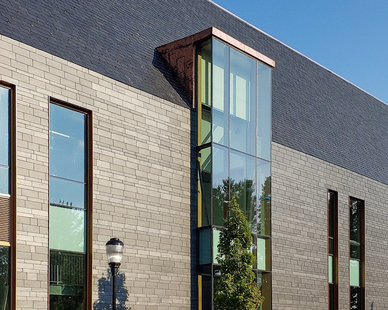 A mix of vertical windows and natural slate by CUPACLAD® creates a unique exterior design while also providing durable building materials.
