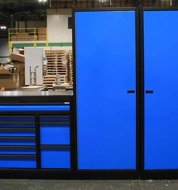 Moduline Cabinets' PROII™ Series in black anodized frames with custom blue powder coat exterior is a great addition to any garage, craft room or any other space that needs cabinets.