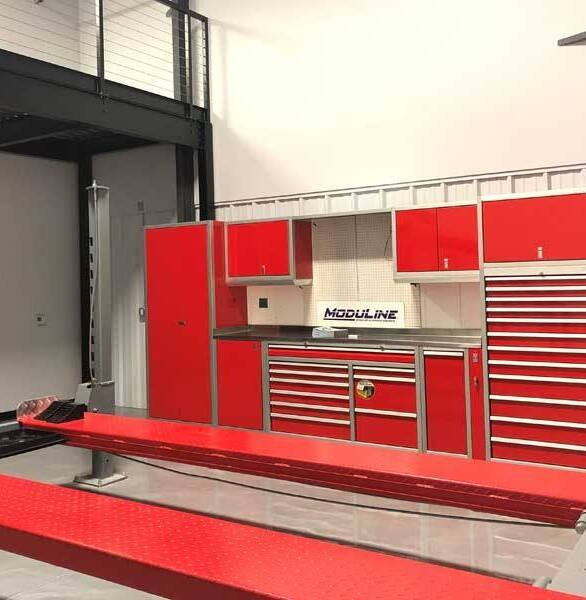 Want a custom garage? Moduline has many different options.  This Moduline's PROII™ Series in red aluminum cabinets is perfect for this garage space.
