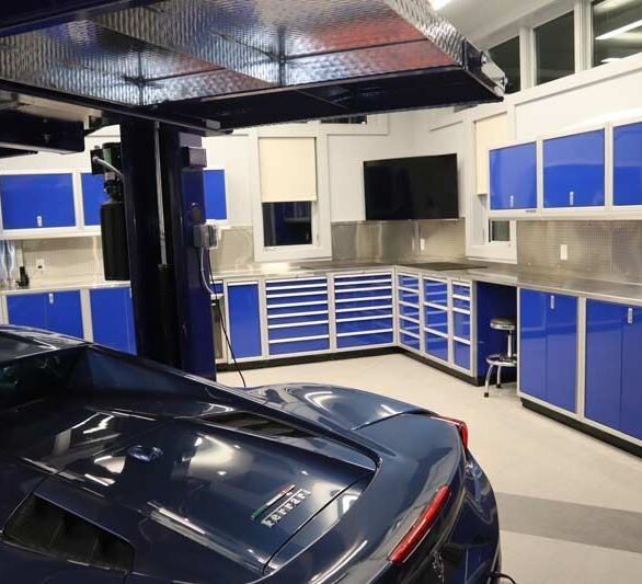 Moduline blue aluminum cabinets in a client's dream garage.  Work with Moduline to create custom cabinet layout.