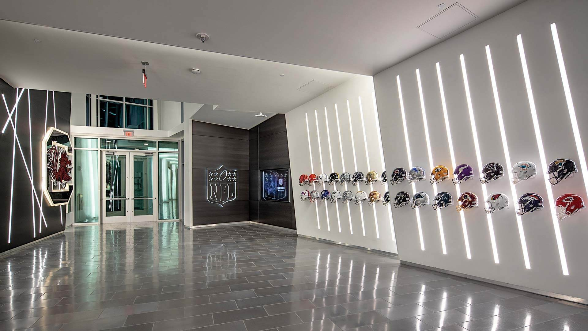 The University of South Carolina Long Family Football Operations Center is located in Columbia, SC featuring lighting products by Acuity Brands - Mark Architectural Lighting™. Project in collaboration with Quackenbush Architects + Planners and Acuity Brands agent JG Murphy.   Photographer: Christy Radecic