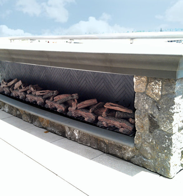 A custom linear fireplace was installed to an outdoor rooftop as a great way to enjoy the evenings while also getting some warmth.