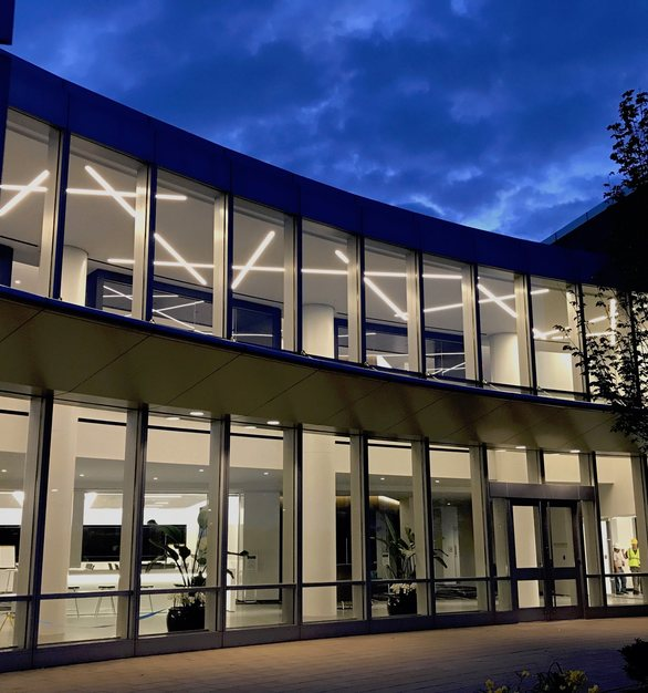The stunning lighting provided by Dado Lighting can be seen from outside the Capital One HQ building in McLean, Virginia.