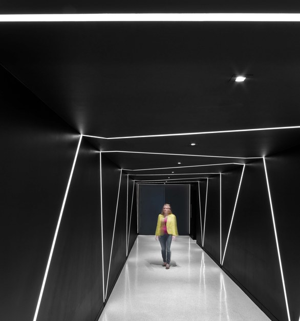 """Draw a line and we'll build a fixture around it."" Dado Lighting did just that here in a hallway at the Sony U.S. headquarters in New York City."