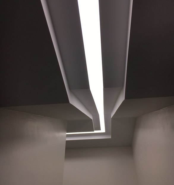 Stunning ceiling design showcasing the SimpleLineLED lighting provided by Dado Lighting.