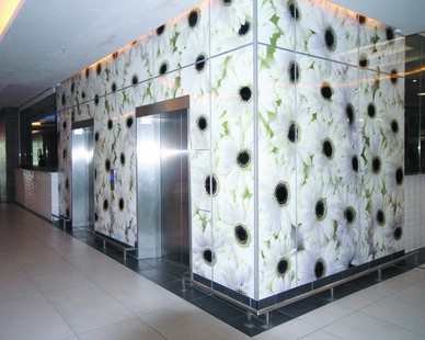 Graphic wall designs are a great way to make a bold statement in your establishment.  Here they are making a statement by the elevators.