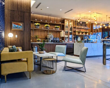 Relax and enjoy a drink and a small treat at the Delmar Hotel's cafe.  Scattered throughout the cafe is some comfy chairs and couches.  Delmar Hotel used Surfacing Solutions solid wood paneling to create a backdrop to the cafe and bar.