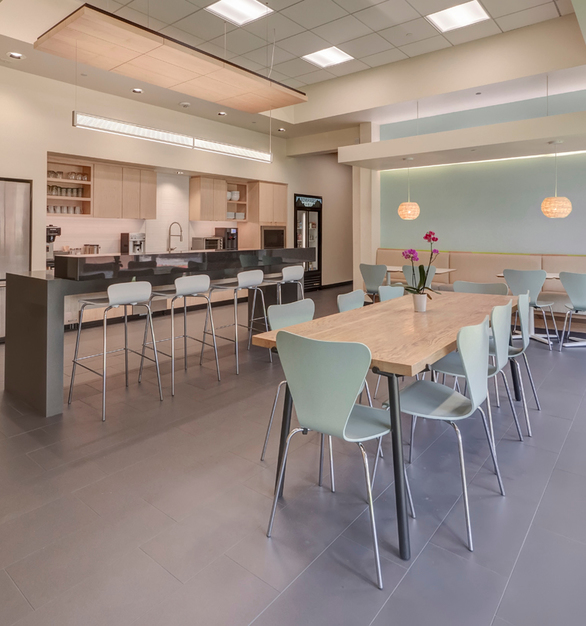 Kitchenette and former chemical developing labs were transformed into the large breakroom, offices,  community workspace, and re-worked server room.