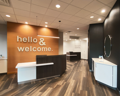 Walk into this welcoming dental office with the warm wood colors, with black and white accents.