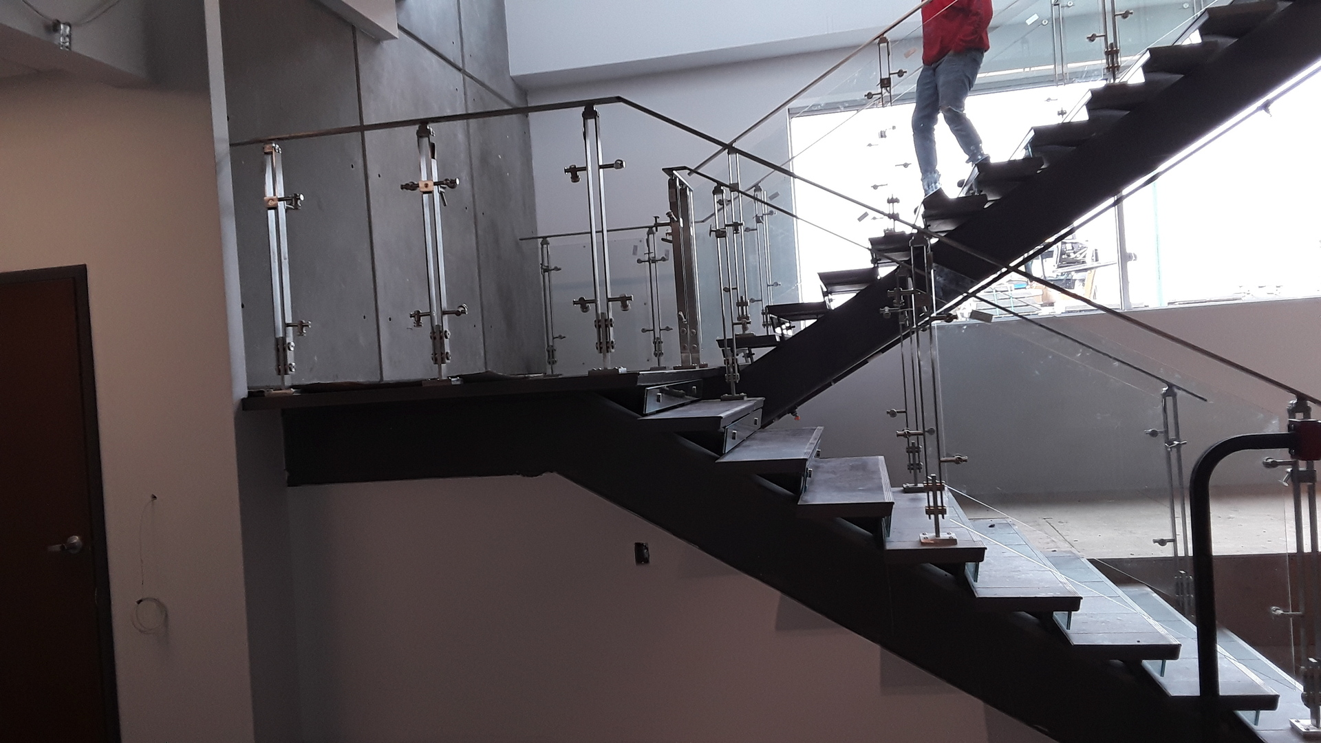 Seen here is Denver Glass Interiors glass railings which are being installed to this education building.