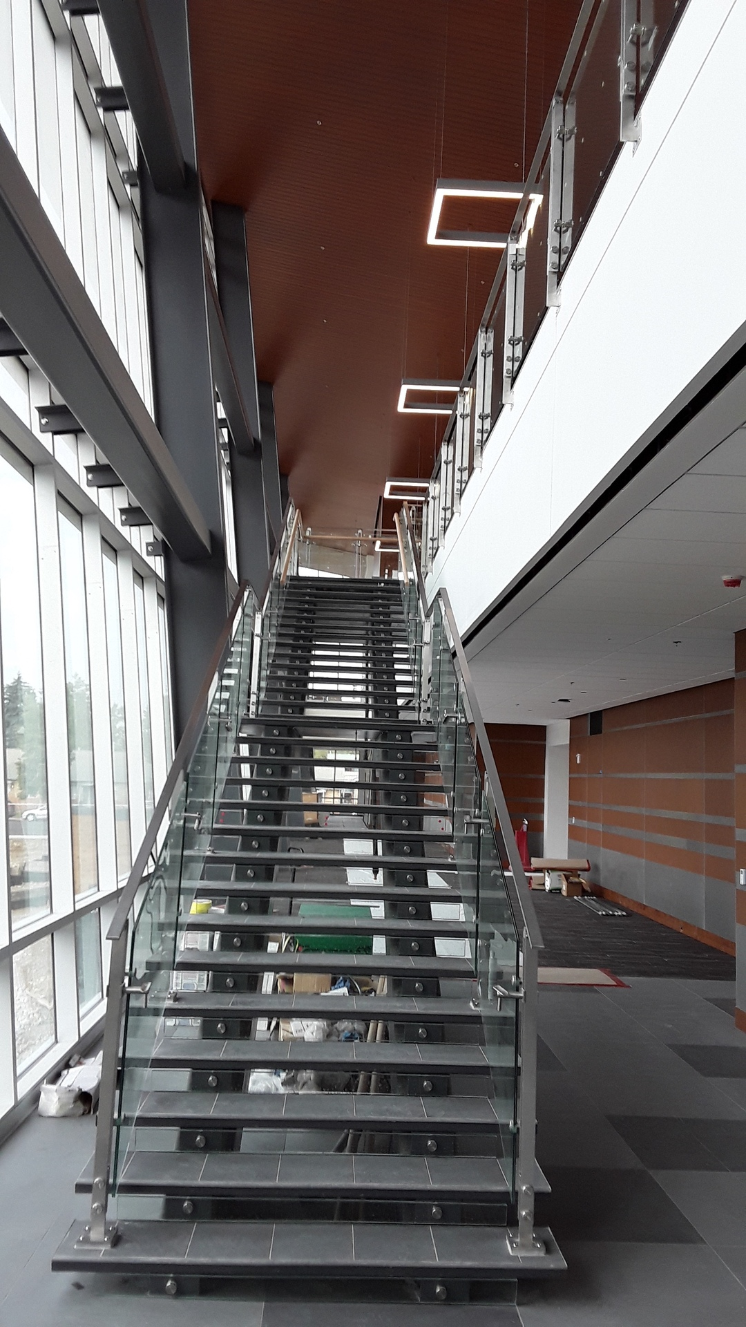 Denver Glass Interior can complete glass railing from the simplest design (seen here) so even something like complex spiral stairways.