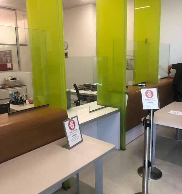 Specialty glass partitions were installed to protect during transactions at the City and County of Denver.