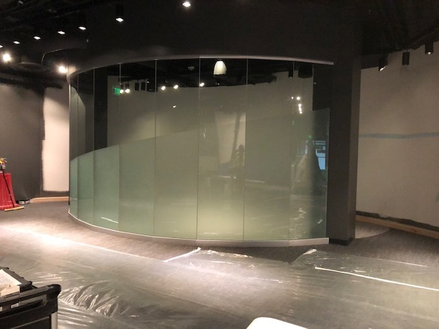 Individual panes of glass are installed here to provide a circular appearance. Denver Glass Interiors installed this beautiful glass.