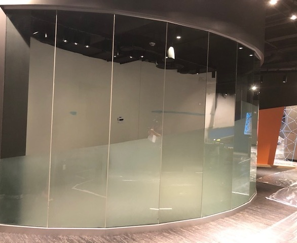 Circular glass can be seen here installed with individual panels, provided by Denver Glass Interiors.