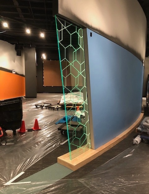 Custom glass is a specialty of Denver Glass Interiors. Her you can see a sleek sheet of glass consisting of octagon shapes.