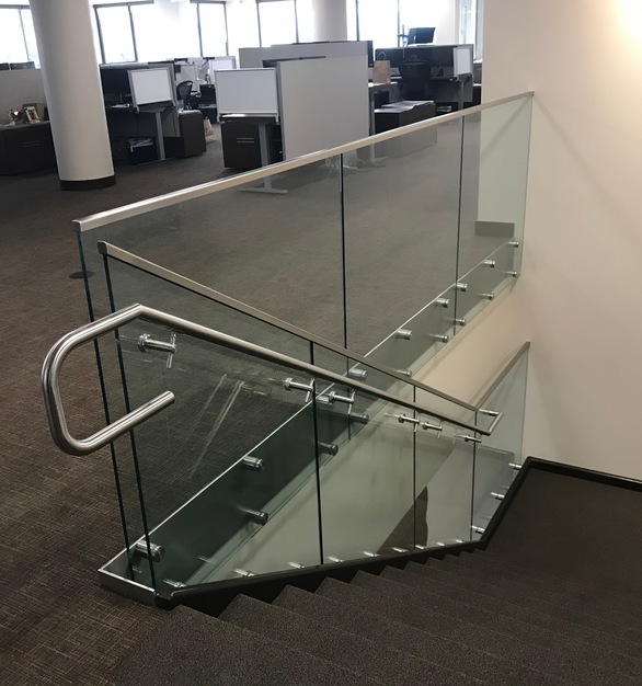 High identity signature office building in Denver's premier Cherry Creek North neighborhood used Denver Glass Interiors for these beautiful glass railings.