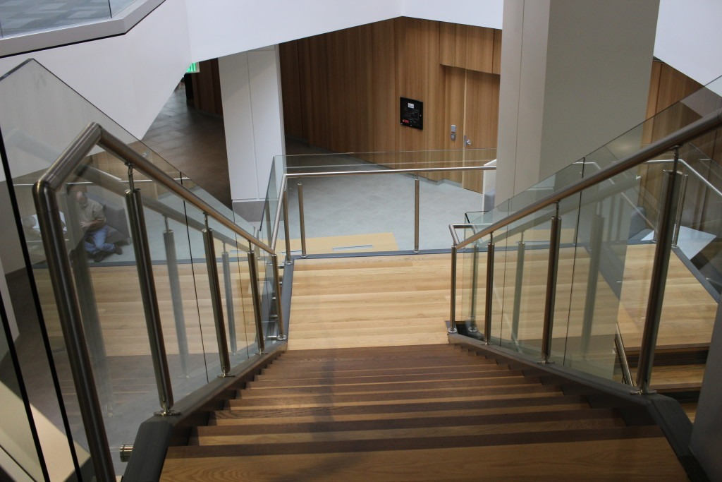 Maverik Laminated Glass is used as railing glass to create a sleek look in this corporate space. This glass is generally considered to be one of the safest glass products on the market, since it does not break into shards or pieces. Instead, if a panel breaks, the glass remains captured by the laminated interlayer.