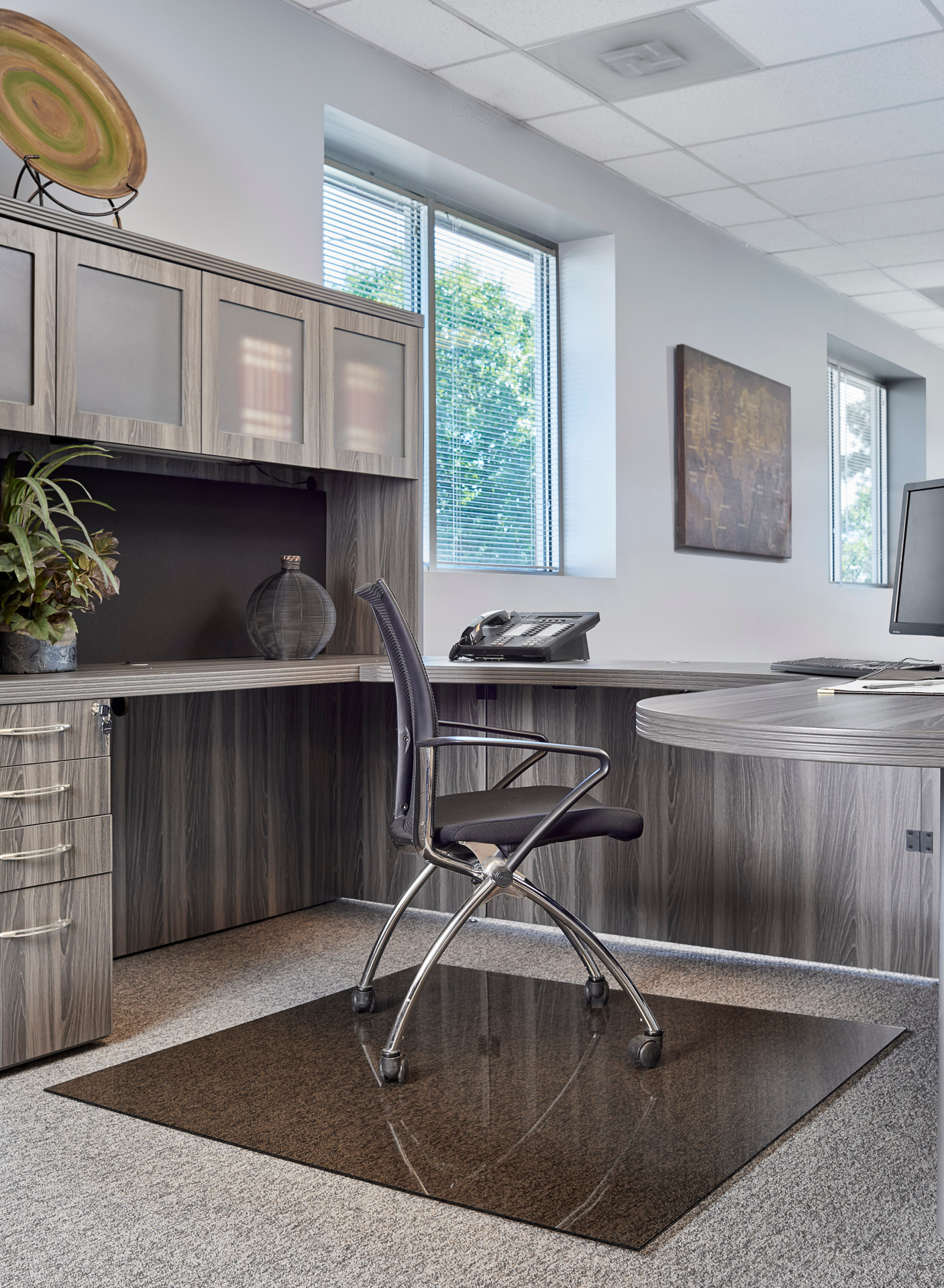 Seen here is Denver Glass Interiors Moltin Glass Chair Mat in a standard bronze tint.