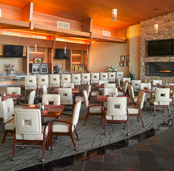 Stylish bar at Desert Willow featuring chairs provided by Gasser Chair.
