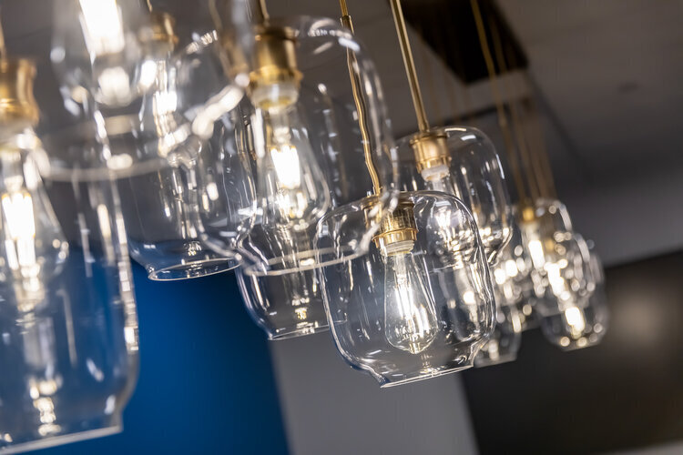 Gorgeous clear glass globe hanging pendants adorn the SRF Consulting Offices.