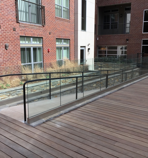 The glass railings Denver Glass Interiors created for this ramp provides an open, airy aesthetic feel.