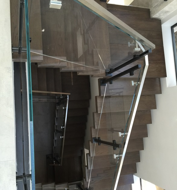 Denver Glass Interiors provides commercial railing systems for today's modern work space. The glass railings they created for this stairway provides an open, airy aesthetic feel.