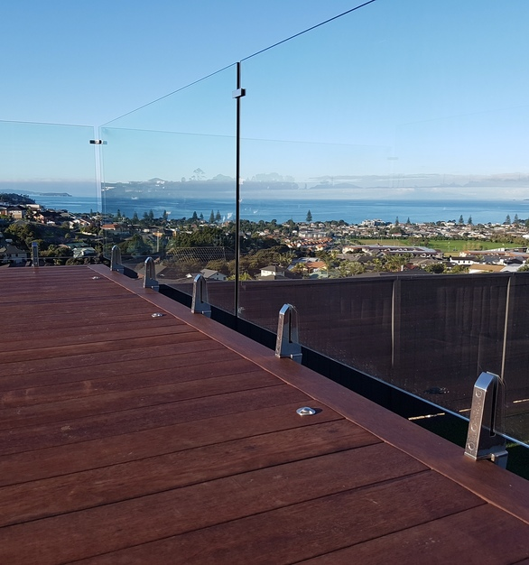 These custom glass railings allow you to see the stunning views, by Denver Glass Interiors.