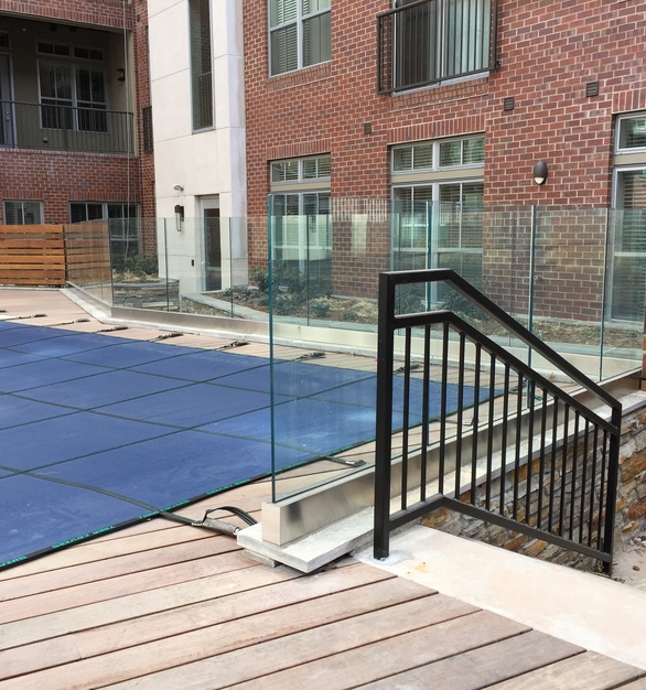 Denver Glass Interiors fabricated, measured, and installed this custom fabricated glass railings for this public pool area.