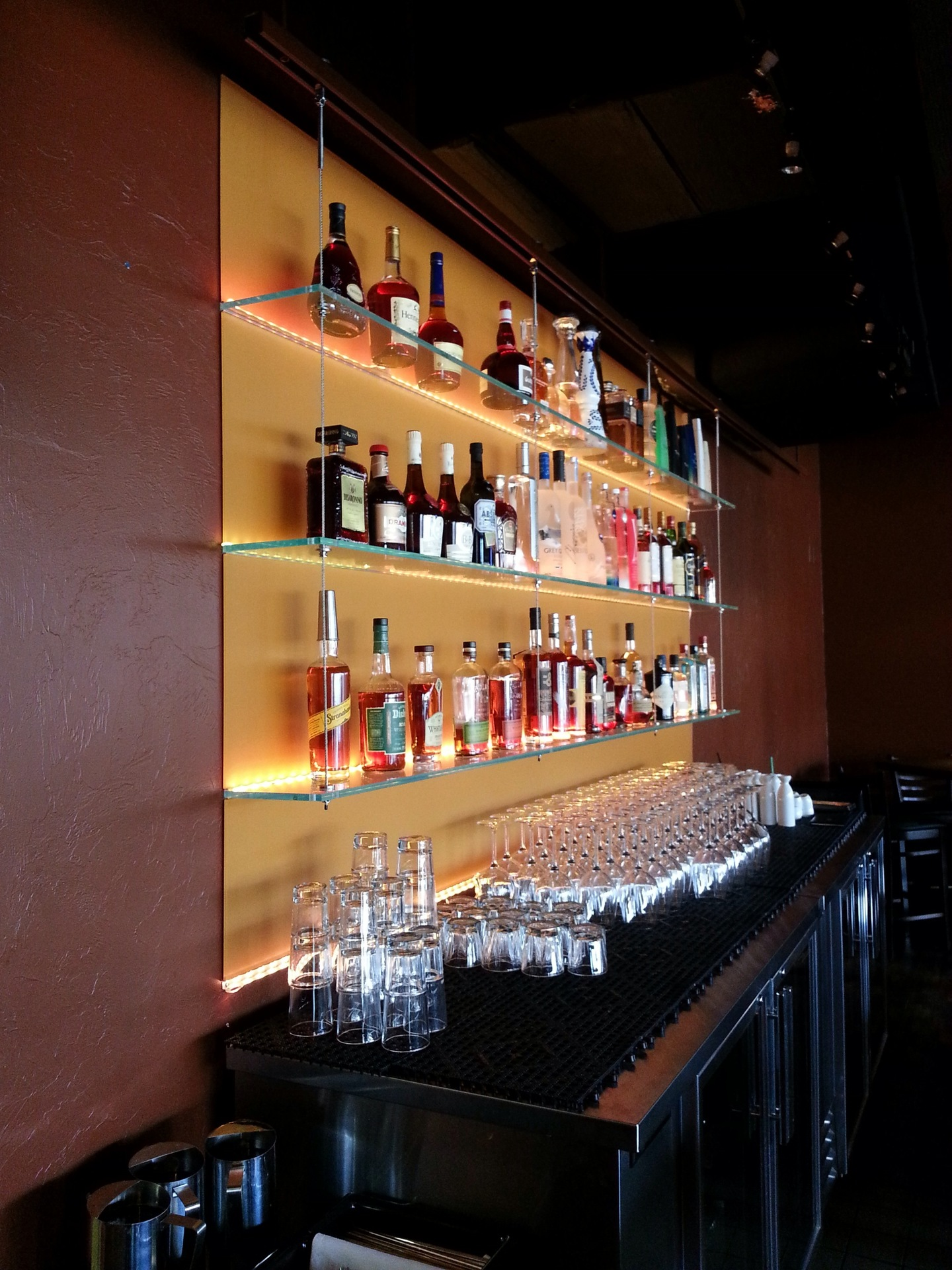 Denver Glass Interiors measured, cut, and installed these custom shelves for this bar.