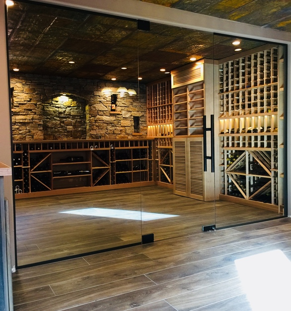 "1/2"" clear tempered glass wine cellar system. Denver Glass Interiors used a unique design with mitered overlapping vertical edges of the door and panels."