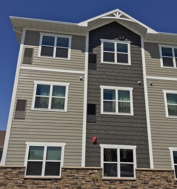 Beautiful siding and trim, by Diamond Kote Building Products.
