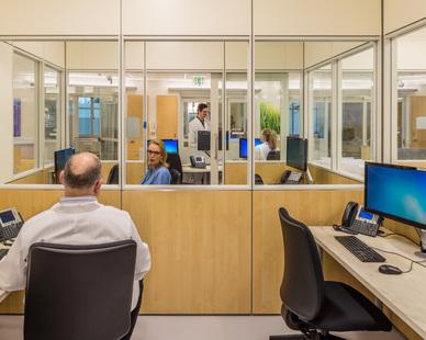 EvergreenHealth photo showing a workspace built using DIRTT custom modular interior solutions.