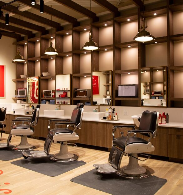 Old Spice Barbershop photo showing a workspace built using DIRTT custom modular interior solutions.