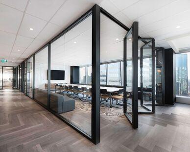 Avison Young photo showing a meeting room built using DIRTT custom modular interior solutions.