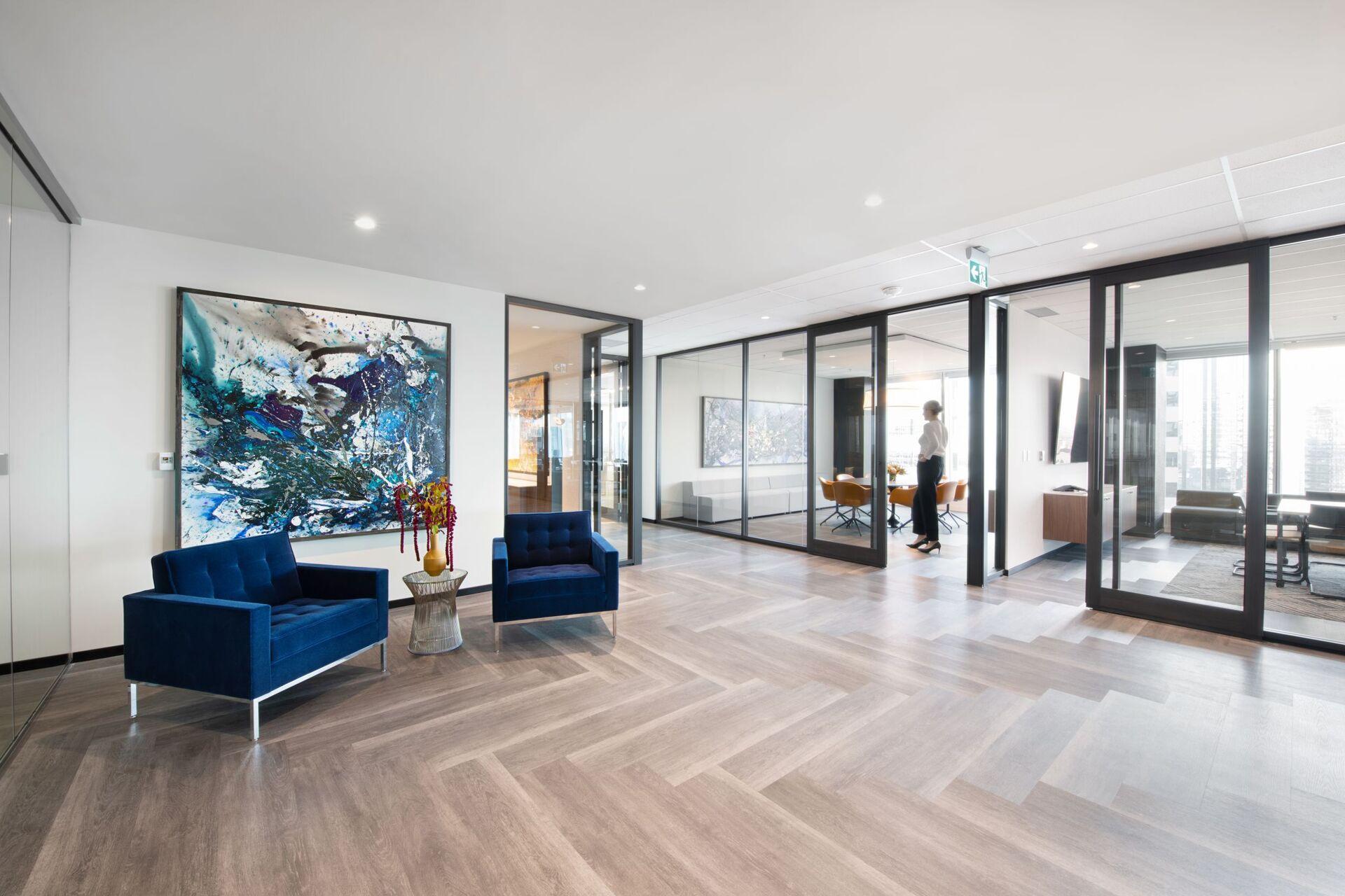 Avison Young photo showing an open space built using DIRTT custom modular interior solutions