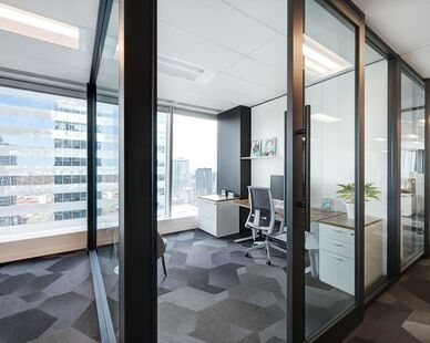 Avison Young photo showing a private office built using DIRTT custom modular interior solutions.
