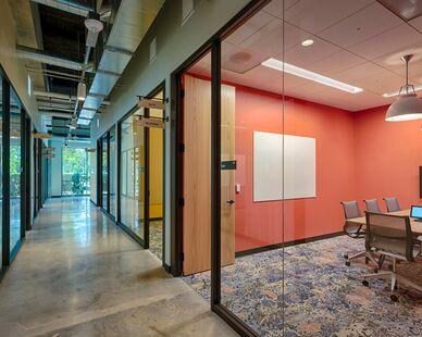 Google Crossman photo showing a meeting room built using DIRTT custom modular interior solutions.