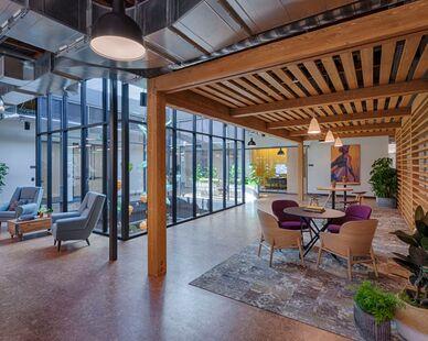 Google Crossman photo showing a workspace built using DIRTT custom modular interior solutions.