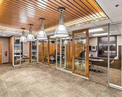PKG Contracting photo showing private office spaces built using DIRTT custom modular interior solutions.